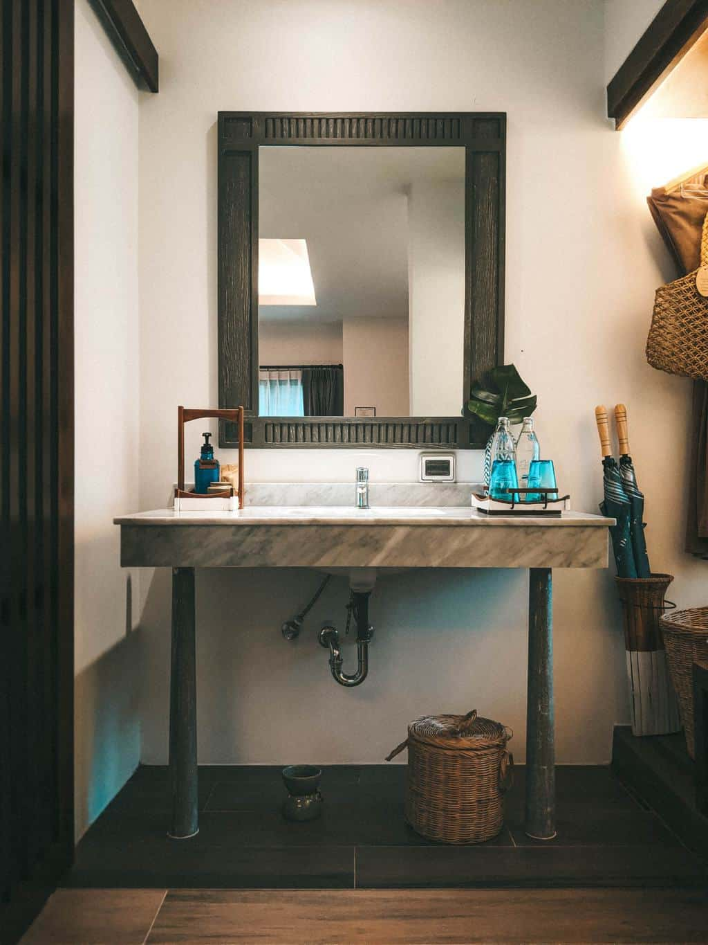 a stylish basin and mirror in a bathroom, spas in thailand, wellness tourism