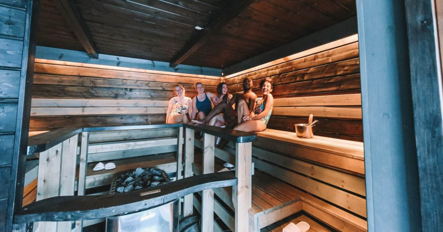 A group of people in a sauna Finnish Lapland, Lapland destinations, Lapland Finland, Inghams