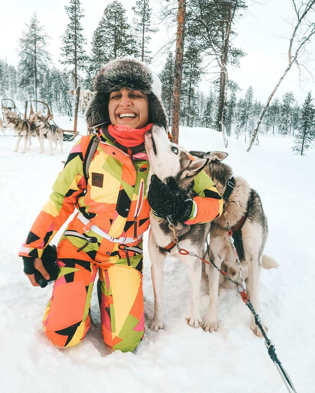 a girl hugging a Siberian husky Finnish Lapland, Lapland destinations, Lapland Finland, Inghams