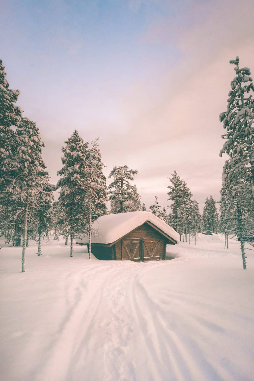 a cabin surrounded by snow Finnish Lapland, Lapland destinations, Lapland Finland, Inghams