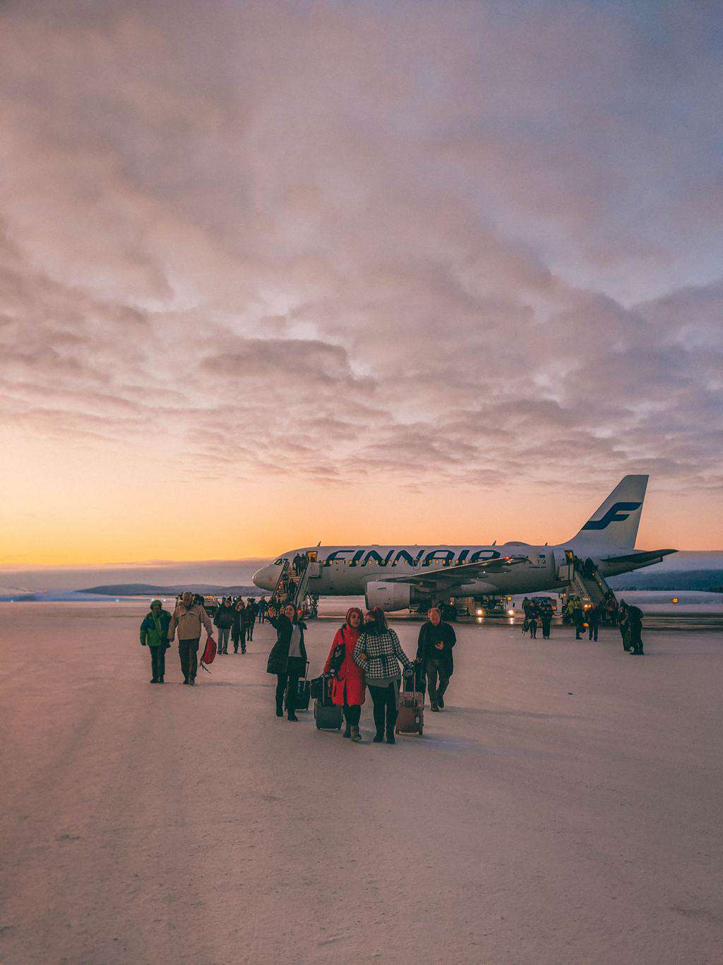 a plan on snow covered tarmac Finnish Lapland, Lapland destinations, Lapland Finland, Inghams, Ivalo Airport