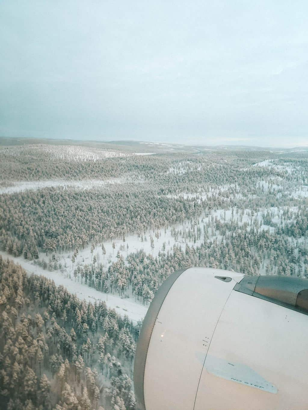 the view from a plane window of snow covered forest Finnish Lapland, Lapland destinations, Lapland Finland, Inghams, Ivalo Airport