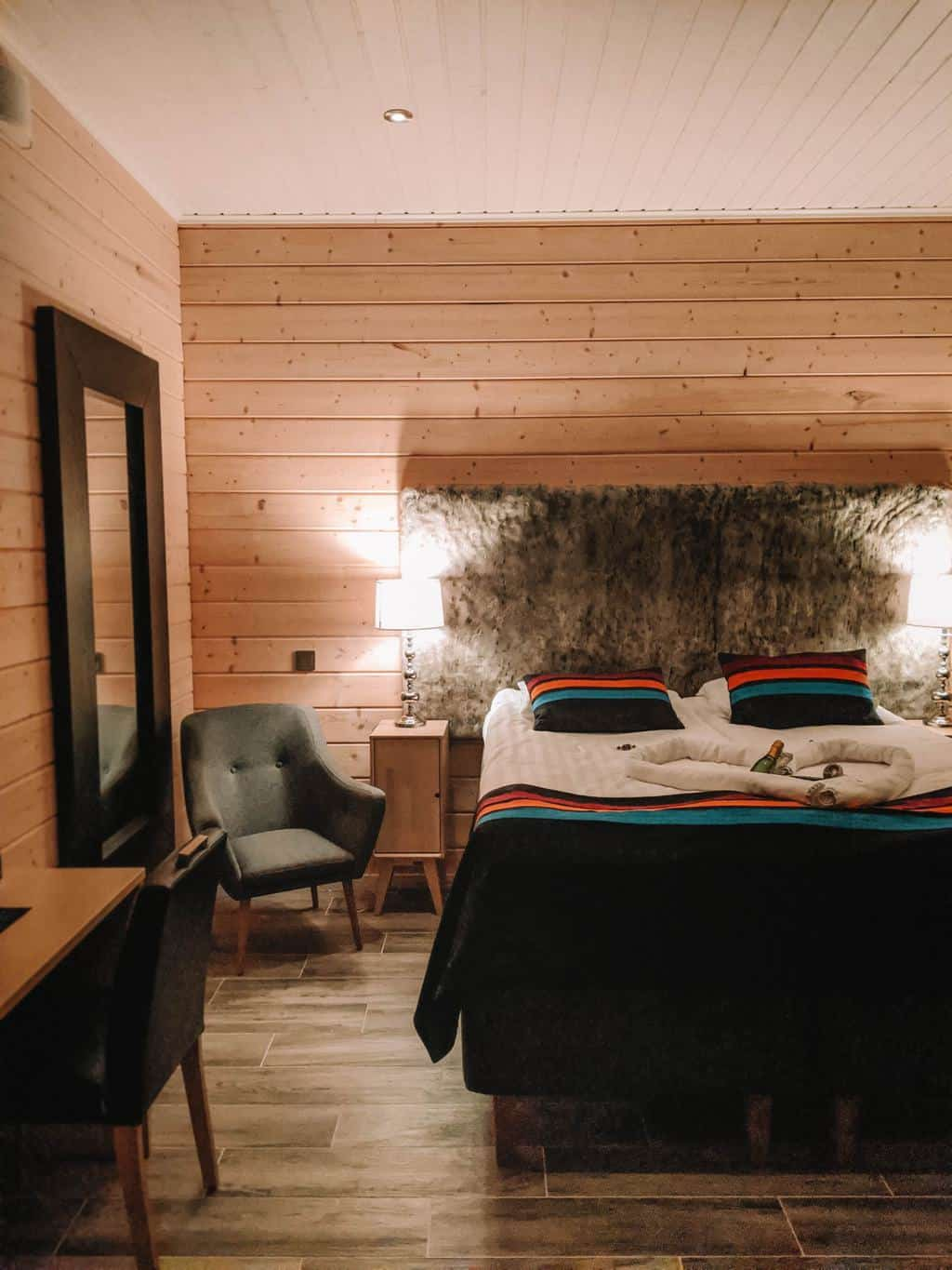 a wood cabin bedroom Finnish Lapland, Lapland destinations, Lapland Finland, Inghams