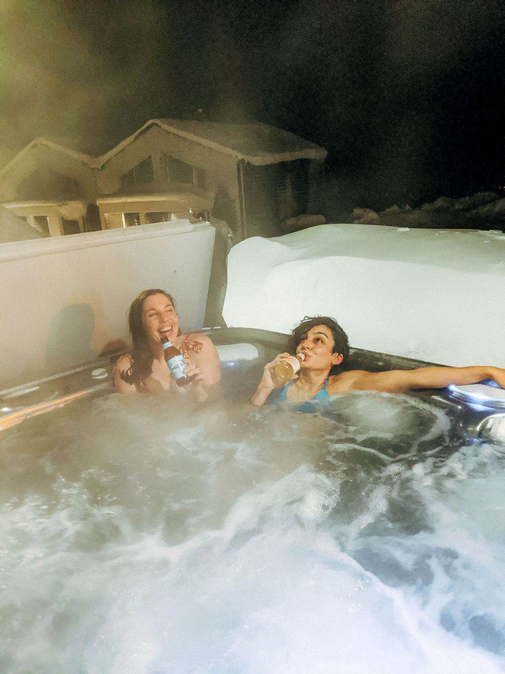 Two women enjoying a beer in a jacuzzi Finnish Lapland, Lapland destinations, Lapland Finland, Inghams