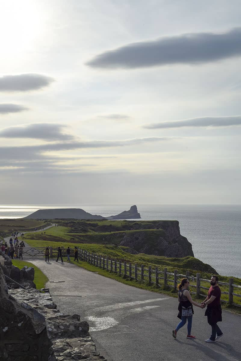 A tarmac path leading to a cliff top